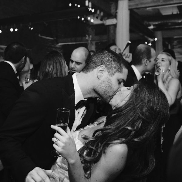 Bride and groom kissing at New Year's Eve wedding