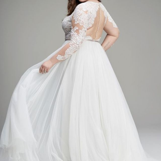 Plus size model in illusion neckline embroidered wedding gown