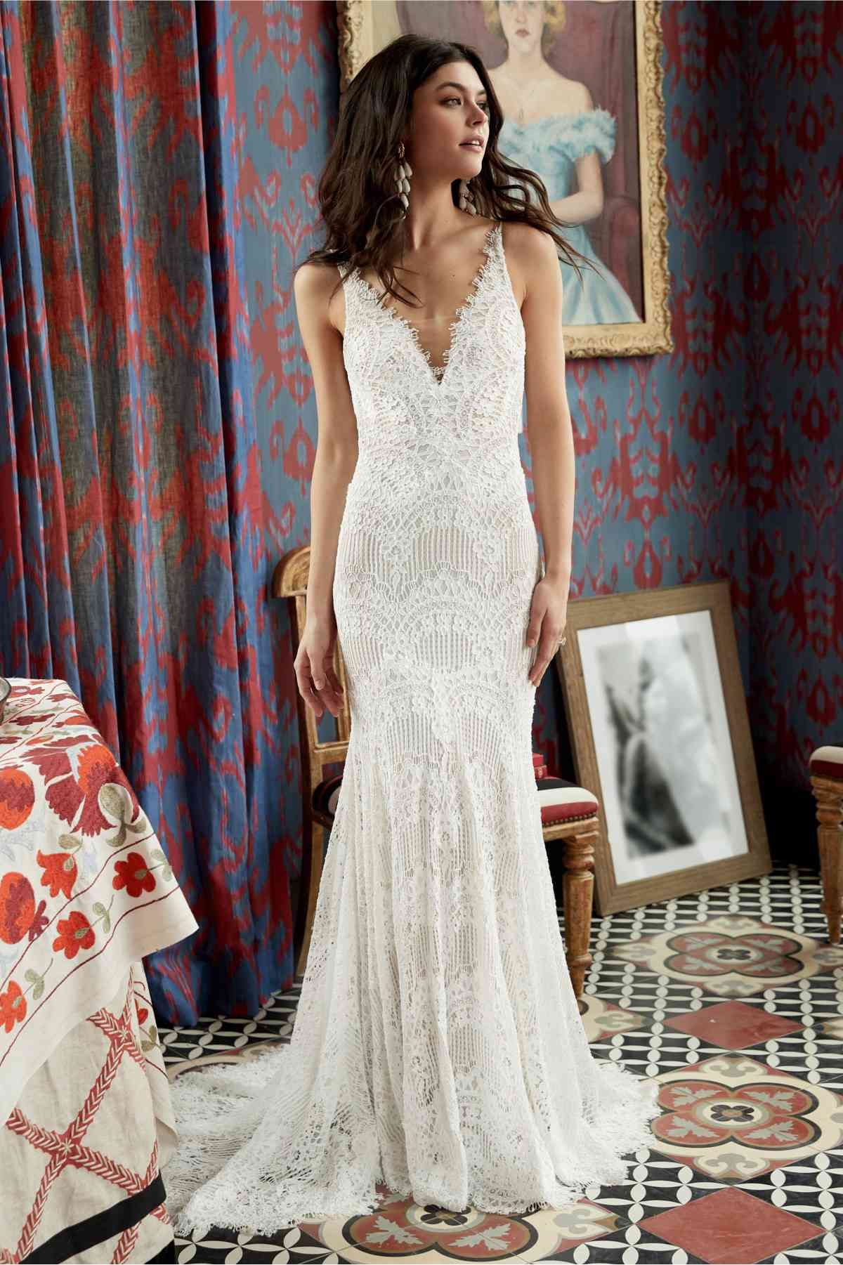 Model in a V-neck geometric lace fit-and-flare gown