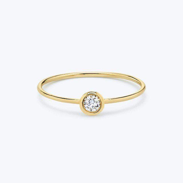 bezel yellow gold ring