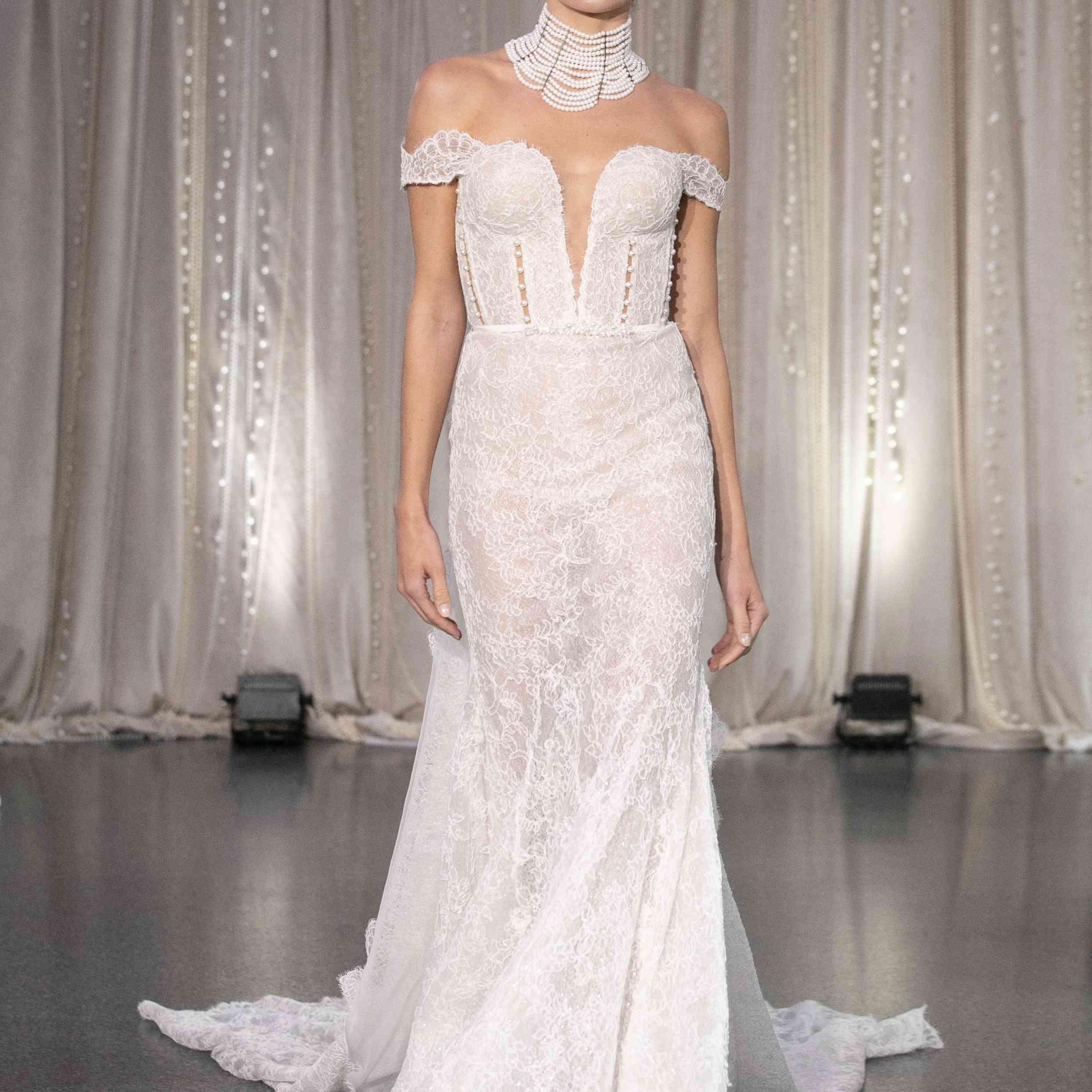 Model in off-the-shoulder mermaid wedding dress
