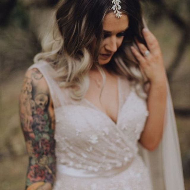 Bride with a sleeve of tattoos wearing an enchanting dress