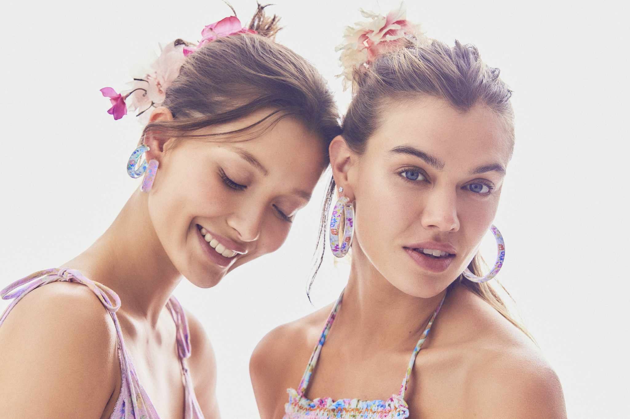 Two girls wearing earrings.