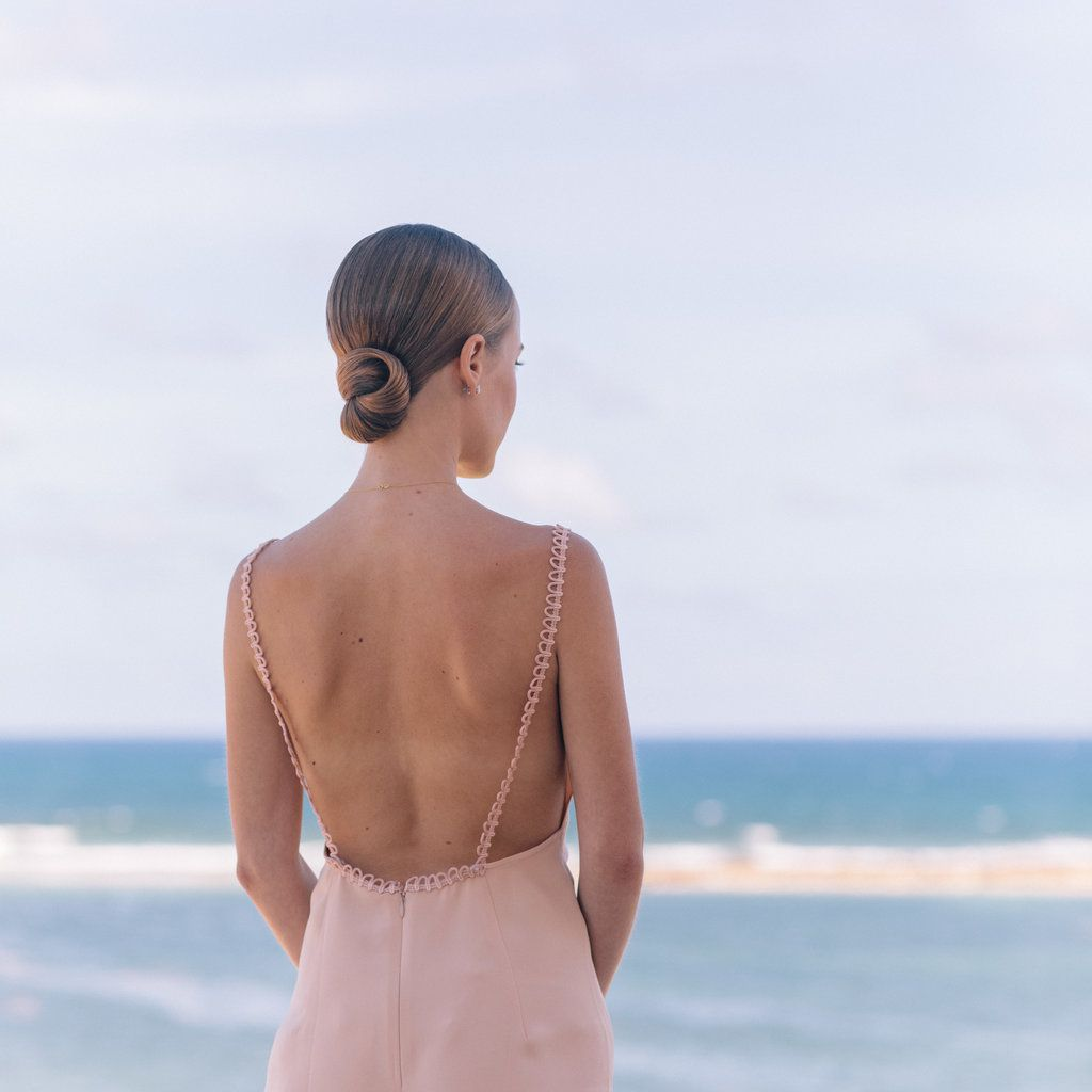 bride in backless dress on beach