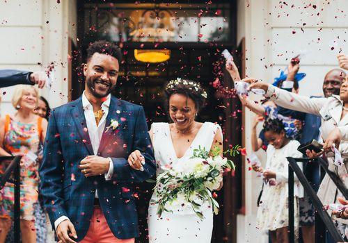 Bride and groom leaving wedding ceremony.