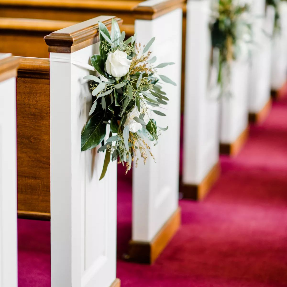 church pews with greenery