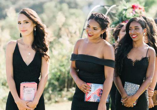 bridesmaids carrying books