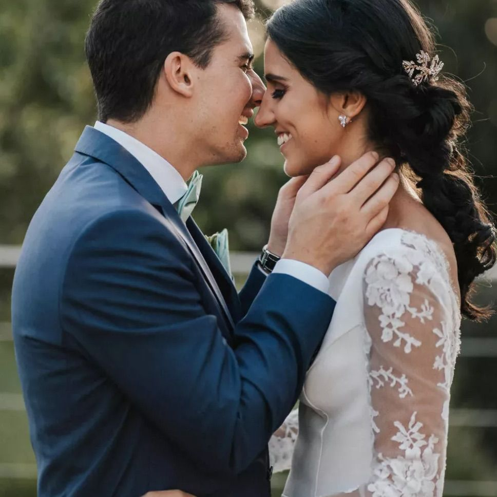 Groom kissing bride with knotted ponytail