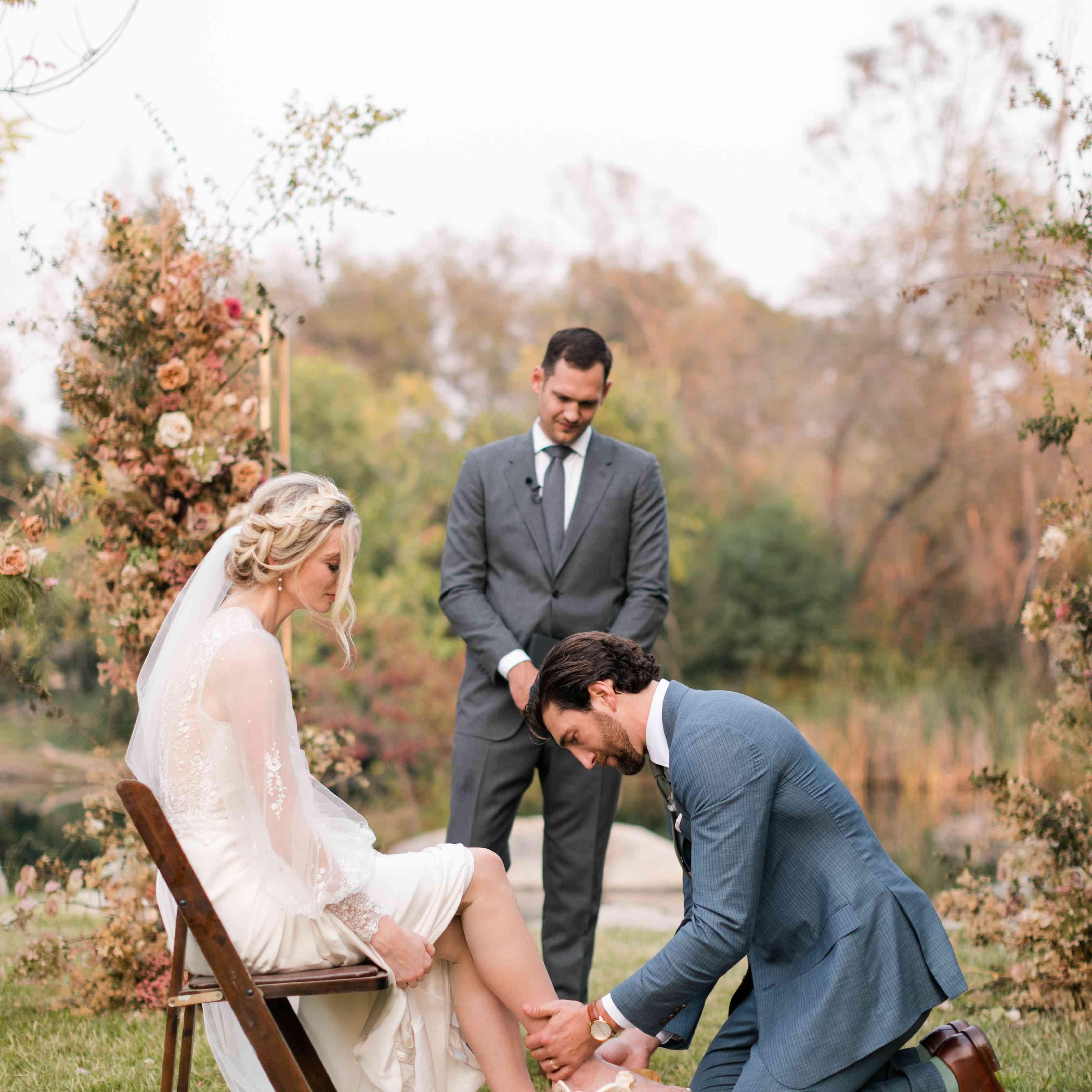 groom washing brides feet