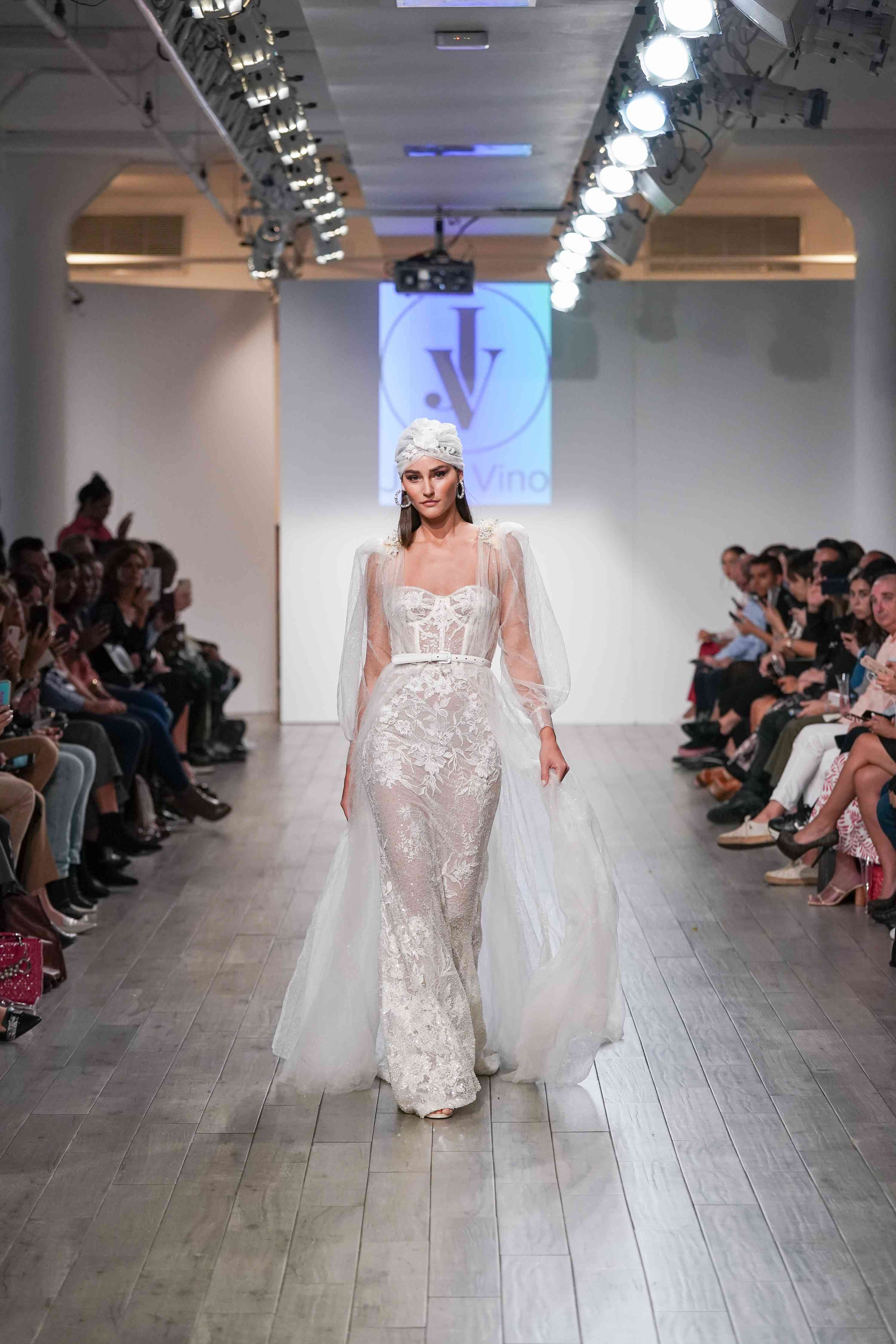 Model in corseted full sleeve wedding dress