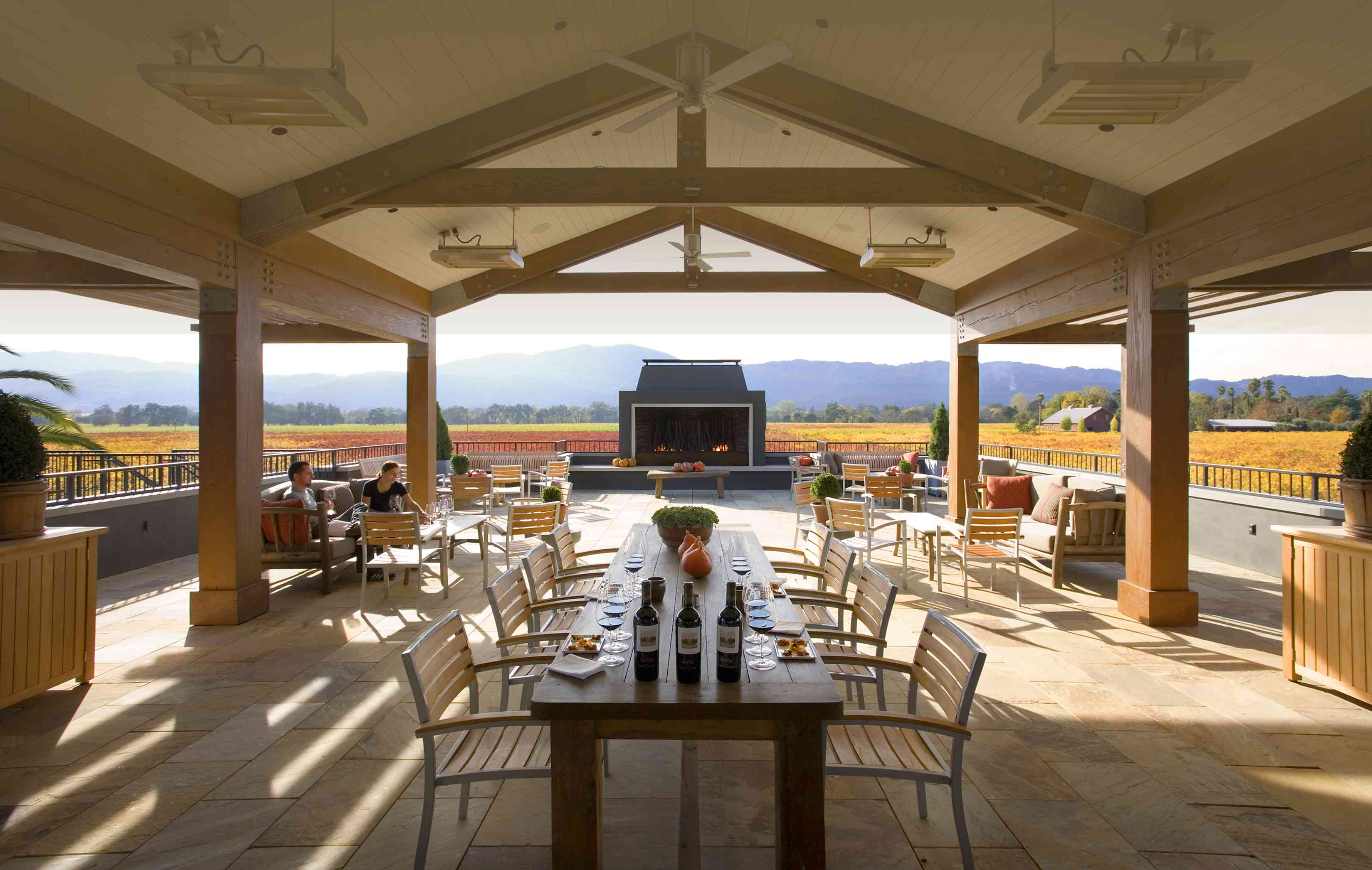 A terrace at Round Pond Estate vineyard with a long table and chairs