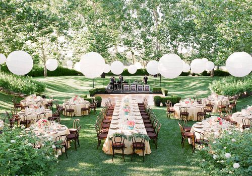 Wedding reception tables with white paper lanterns