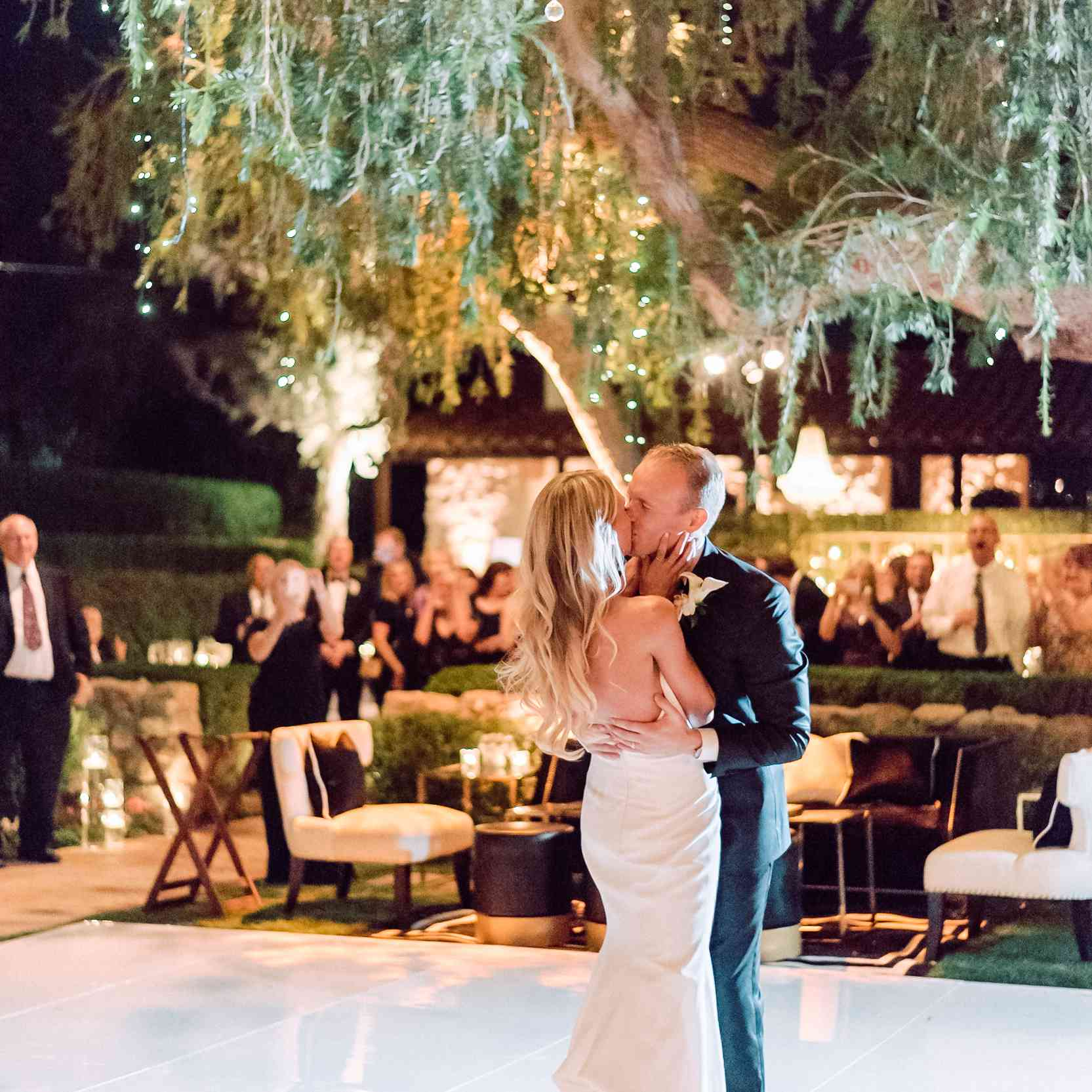 <p>kissing on the dance floor first dance</p><br><br>