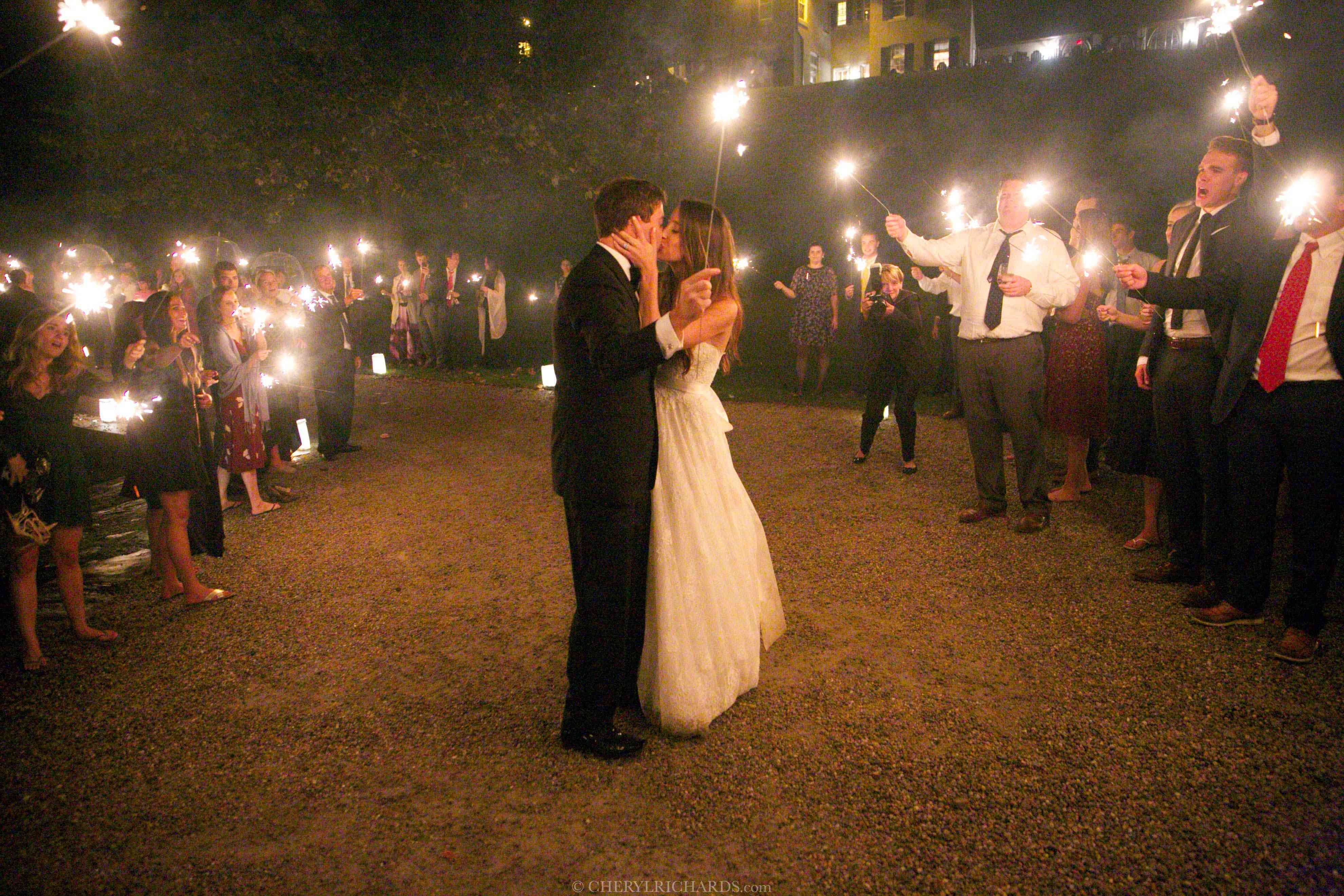 A couple kissing while holding sparklers