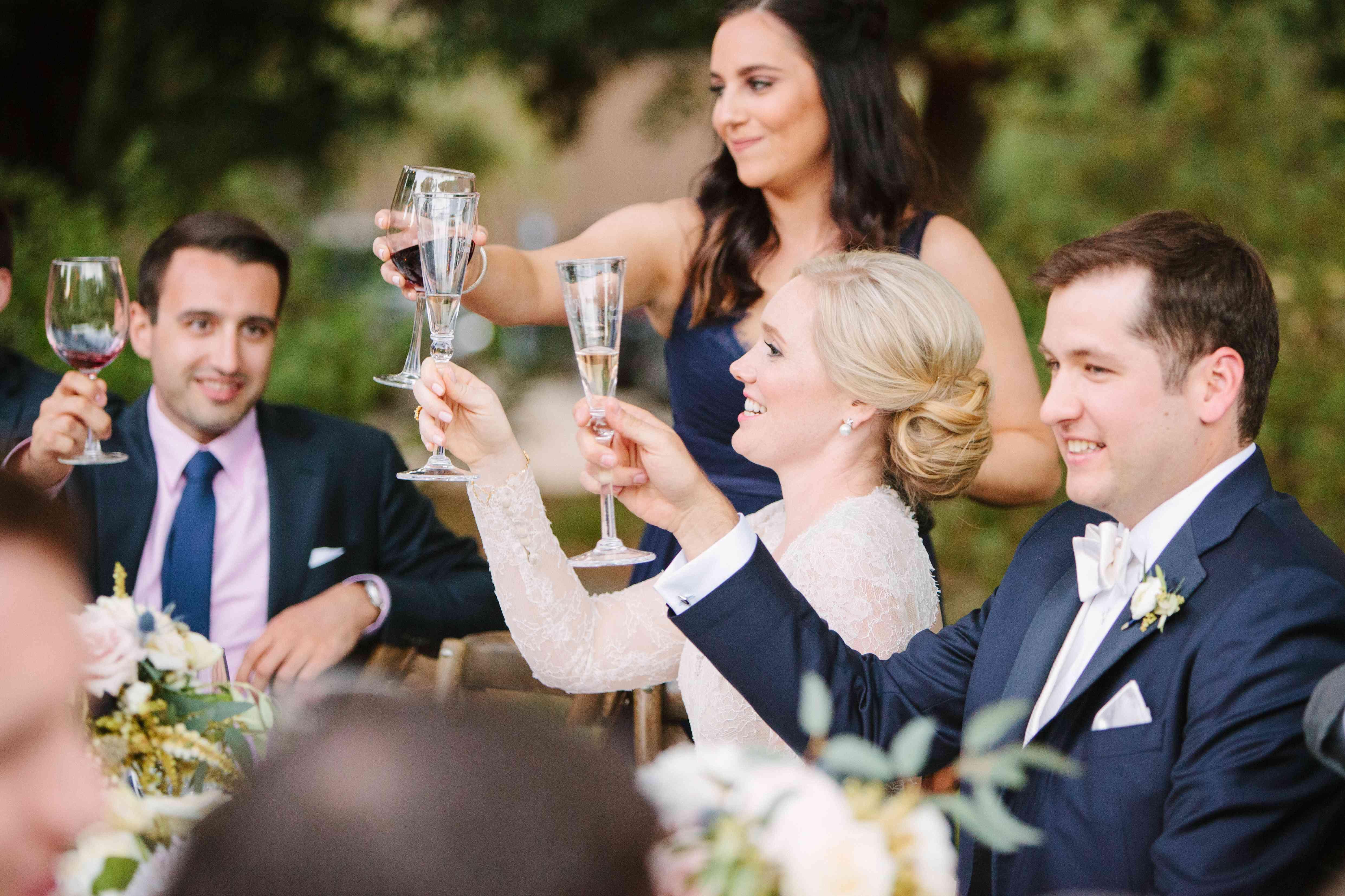 Bride and groom cheers toast