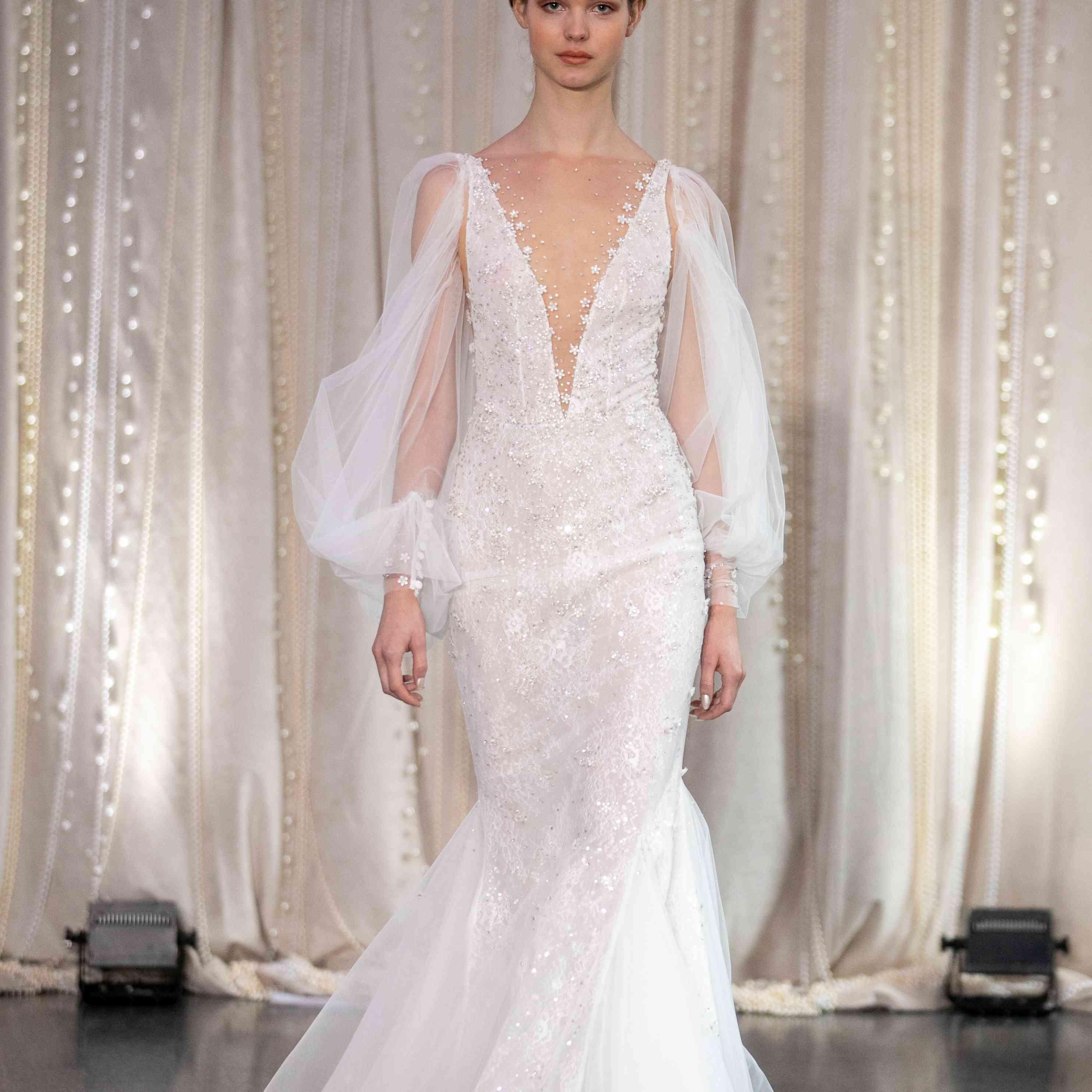 Model in long sleeve mermaid wedding dress