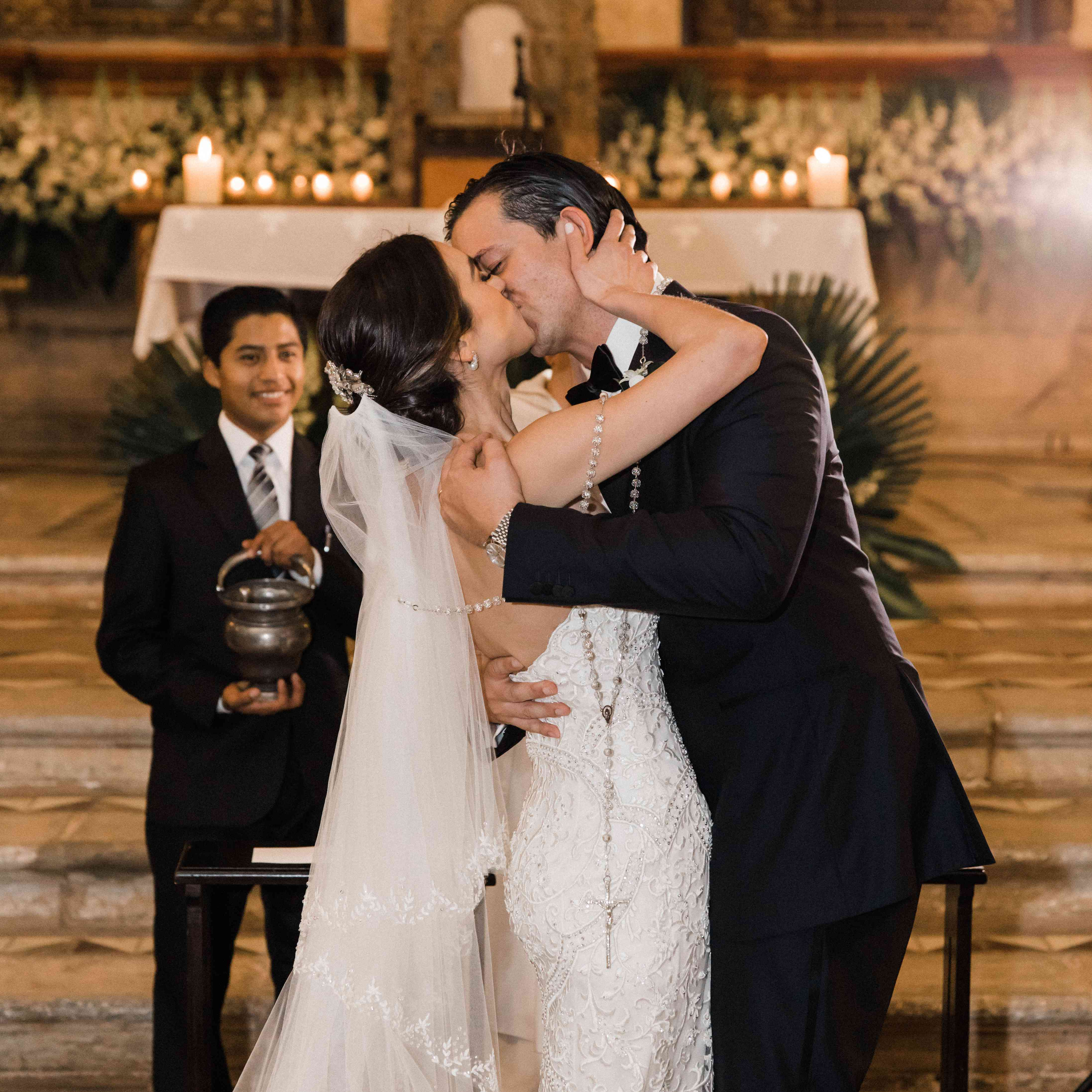 <p>first kiss at altar bride wearing rosary</p><br><br>
