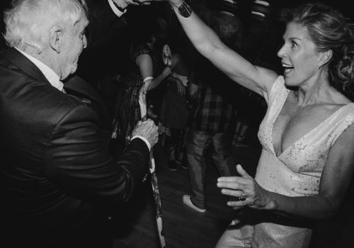 Older couple dancing at a wedding
