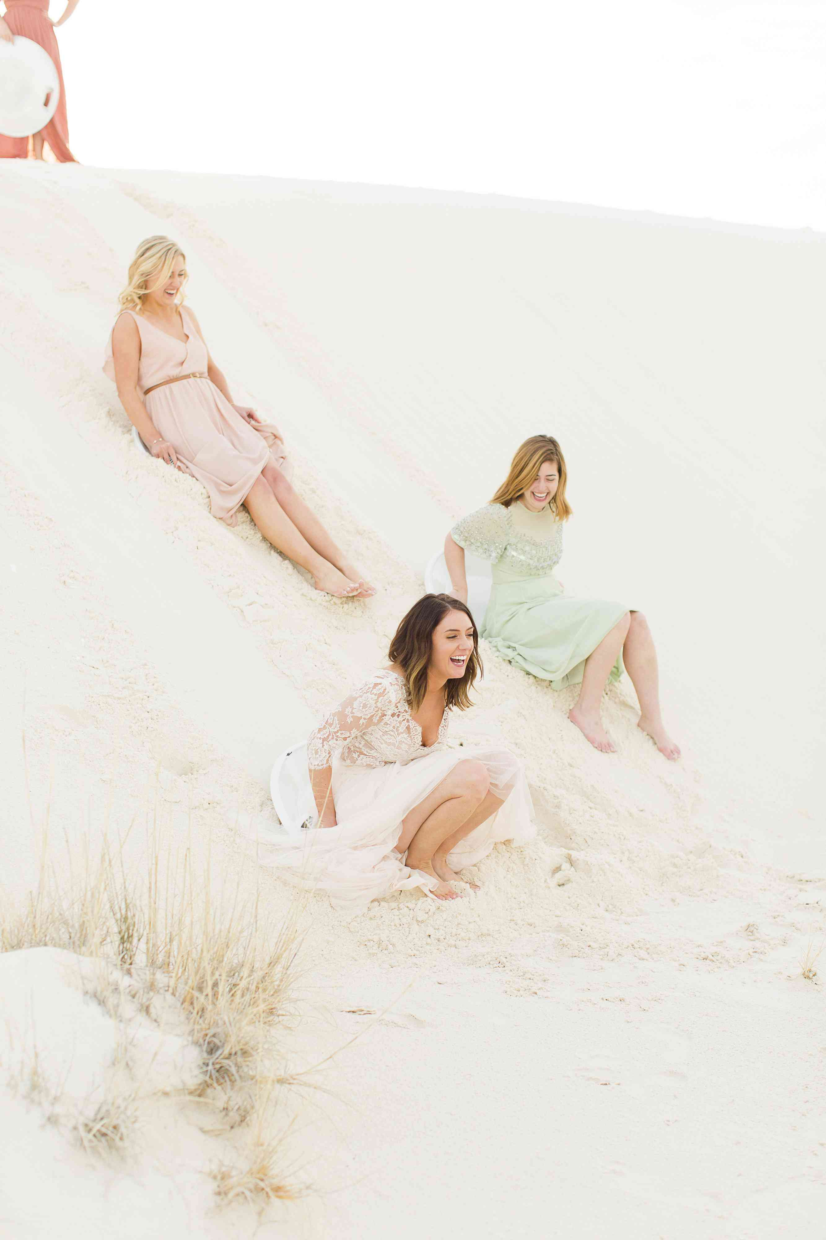 Bride Slides Down Sand Dune