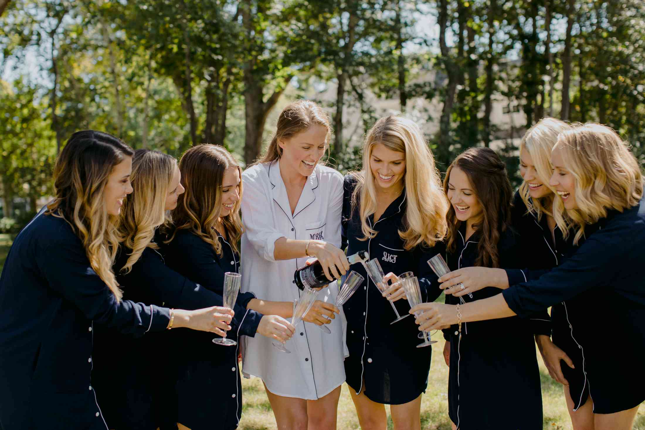 at-home rustic massachusetts wedding, bride drinking champagne and getting ready with bridesmaids