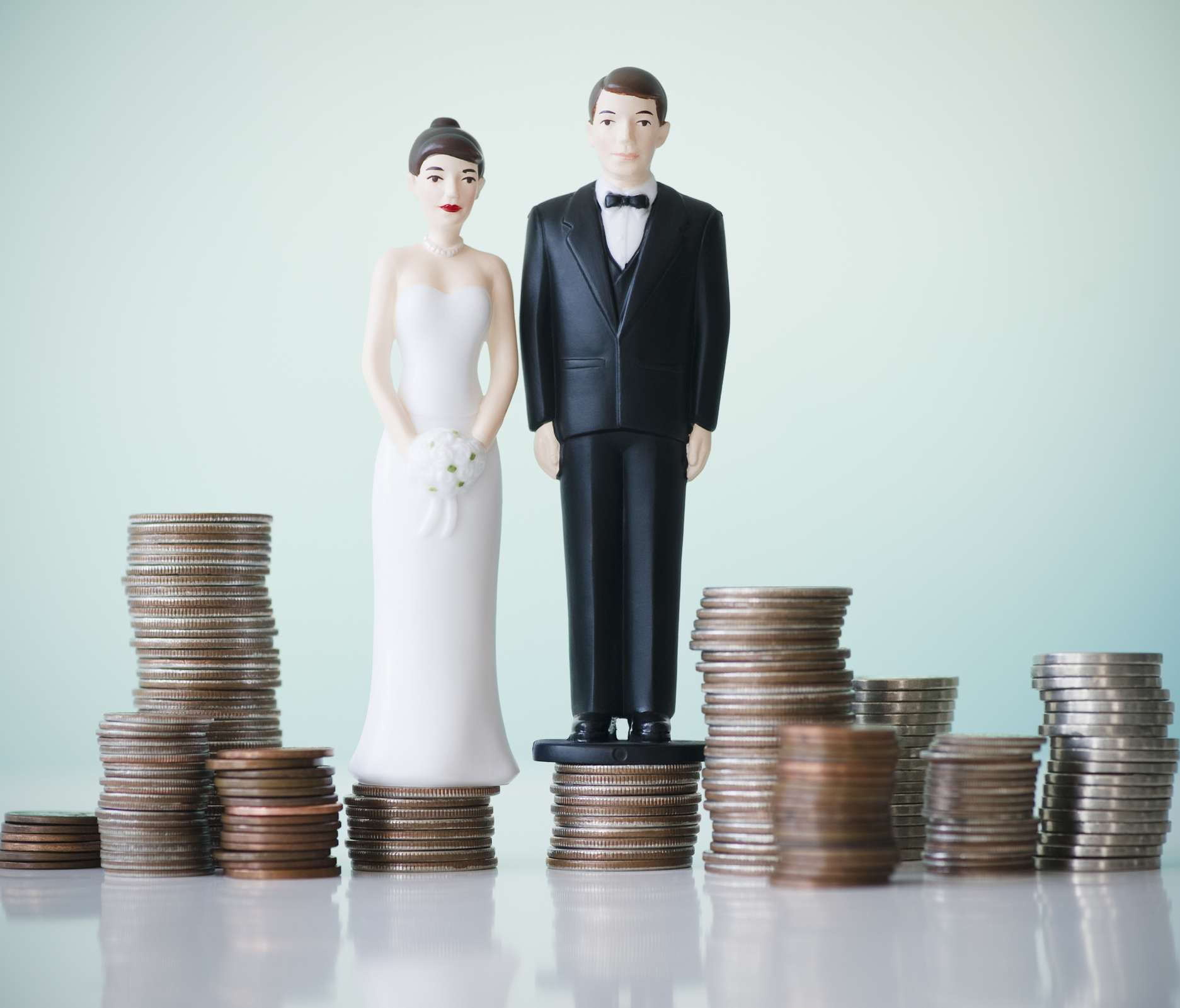 Bride and groom cake toppers on coins