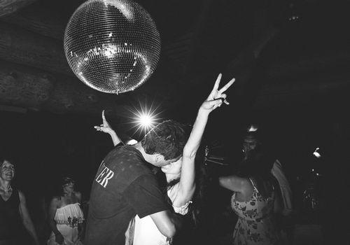 Couple kissing below disco ball