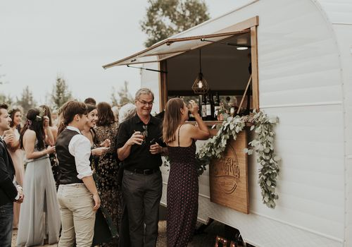 Guests waiting in line at the bar, mobile bar, Swig Rig, outdoor wedding reception