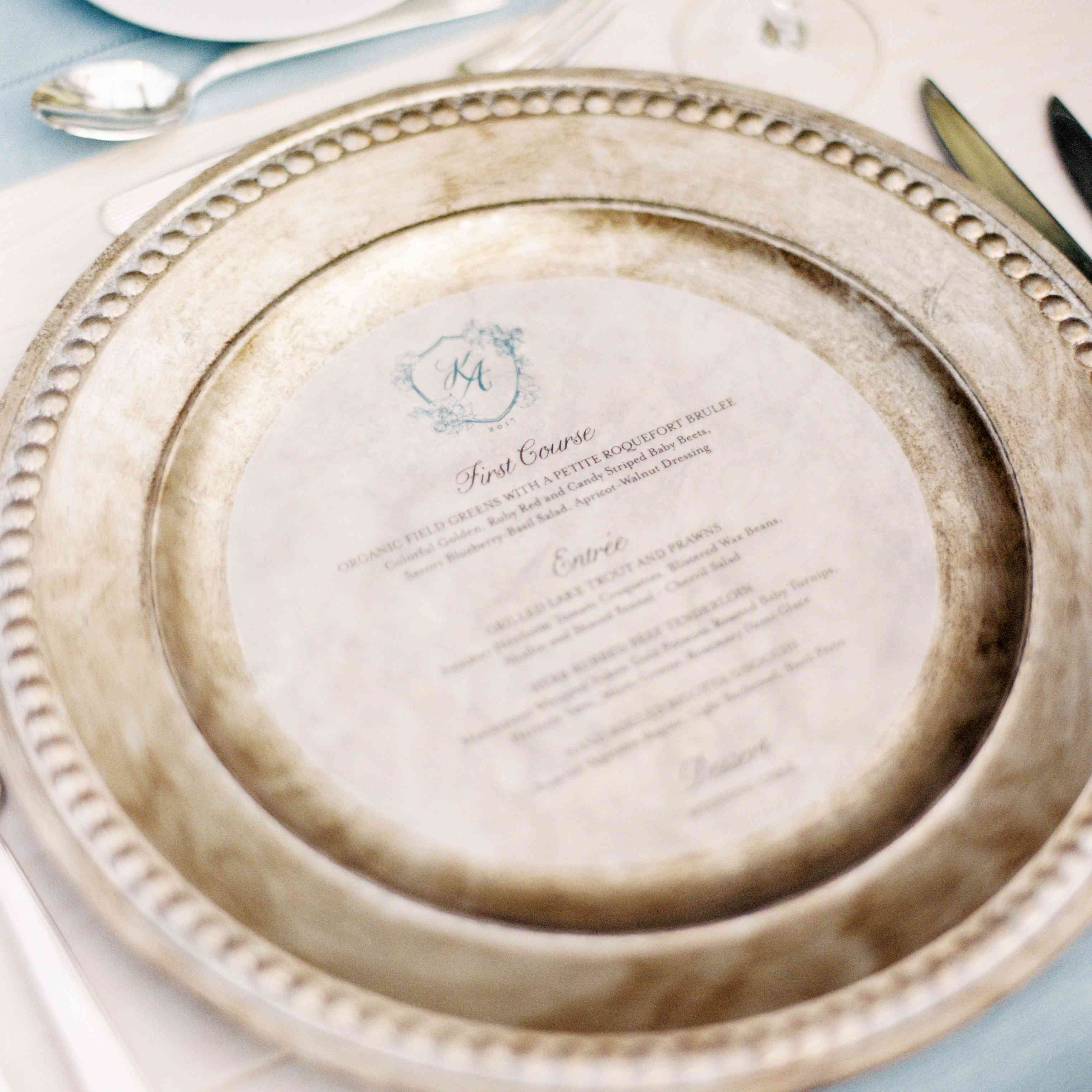 menu on place setting silver charger