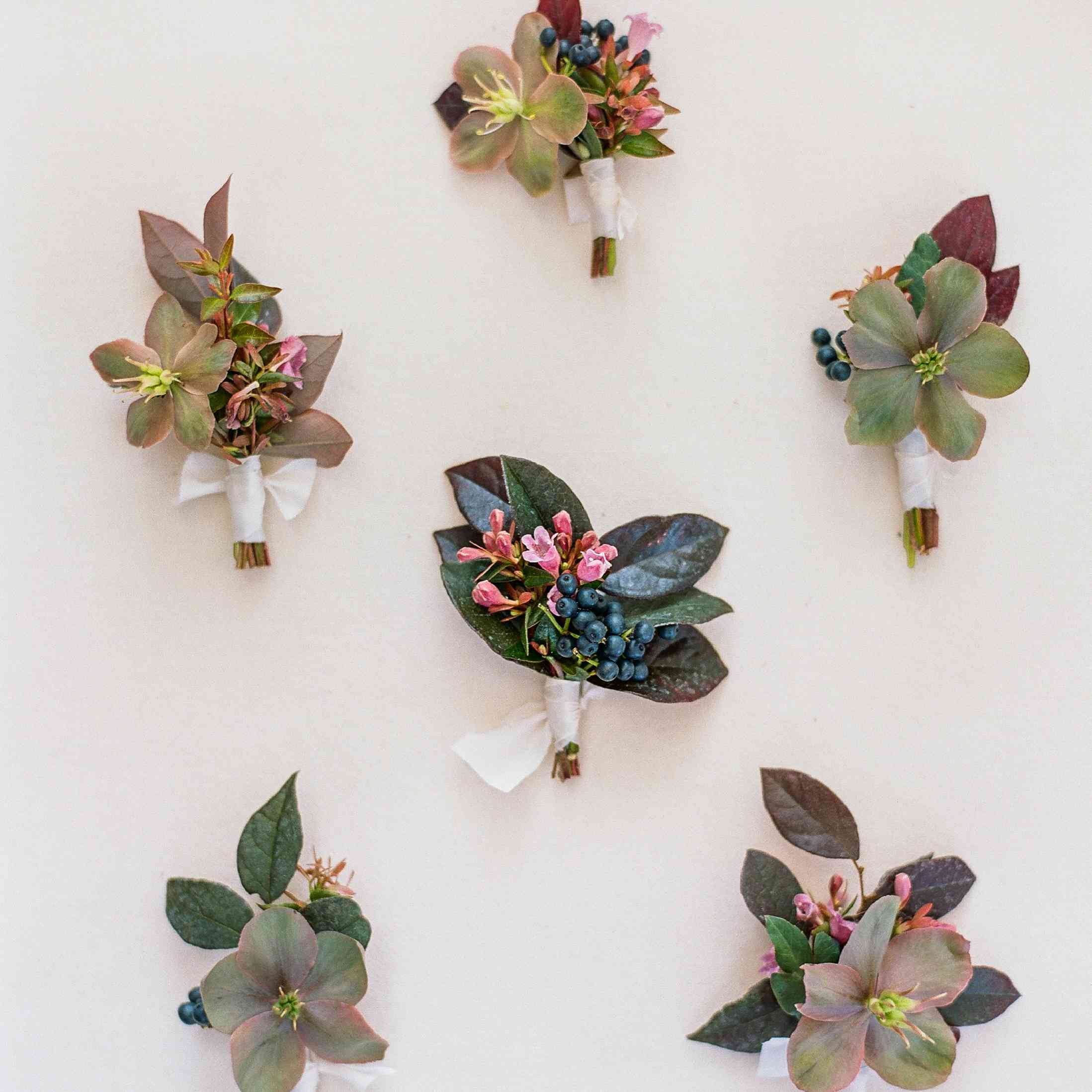 flowers, berries, and greenery boutonniere