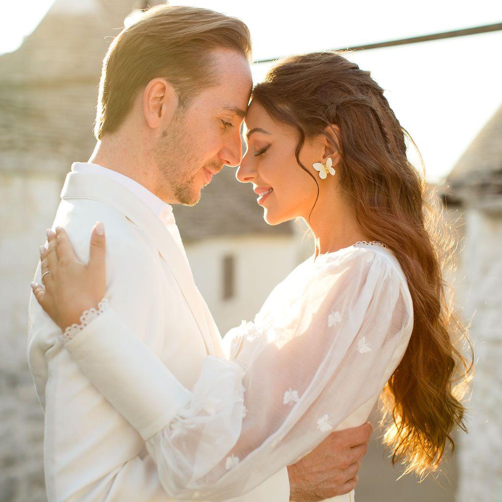 Bride and groom embracing in golden light