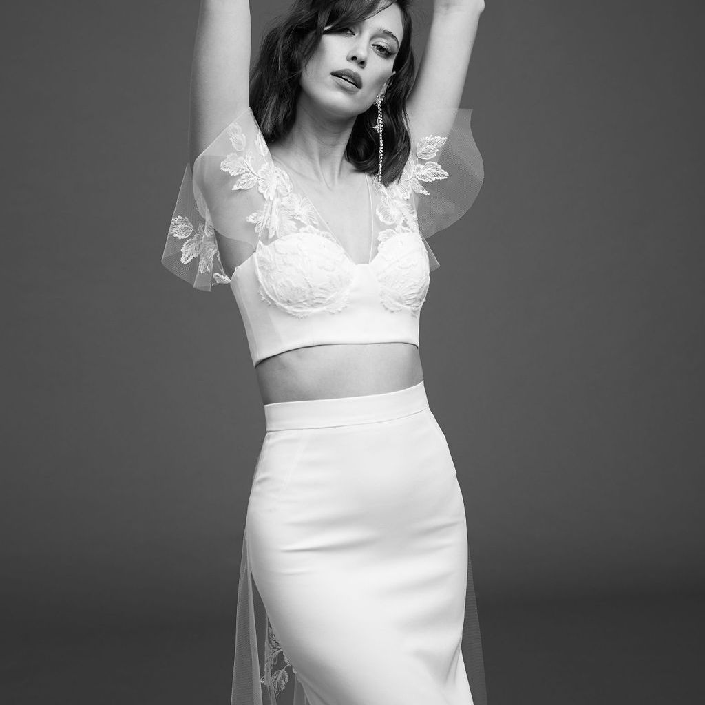 Model in crop top with butterfly sleeves and high waisted skirt