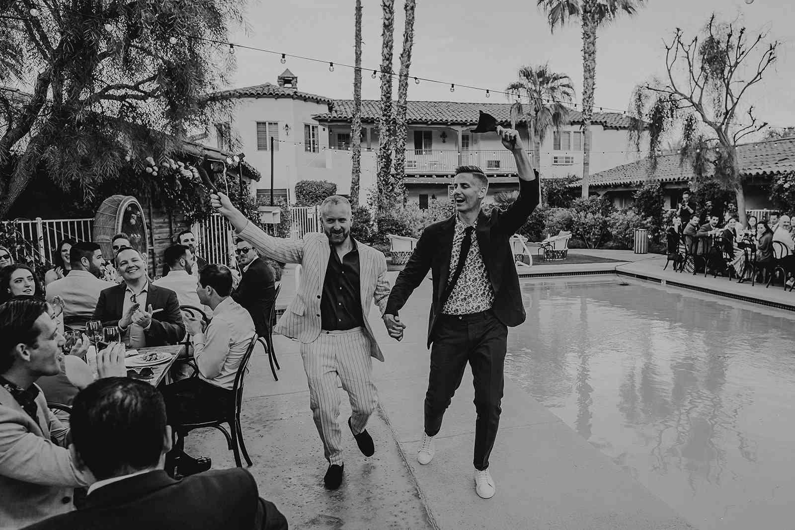 grooms entering reception
