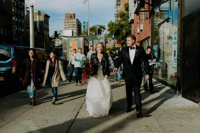 Bride and groom walking down New York street