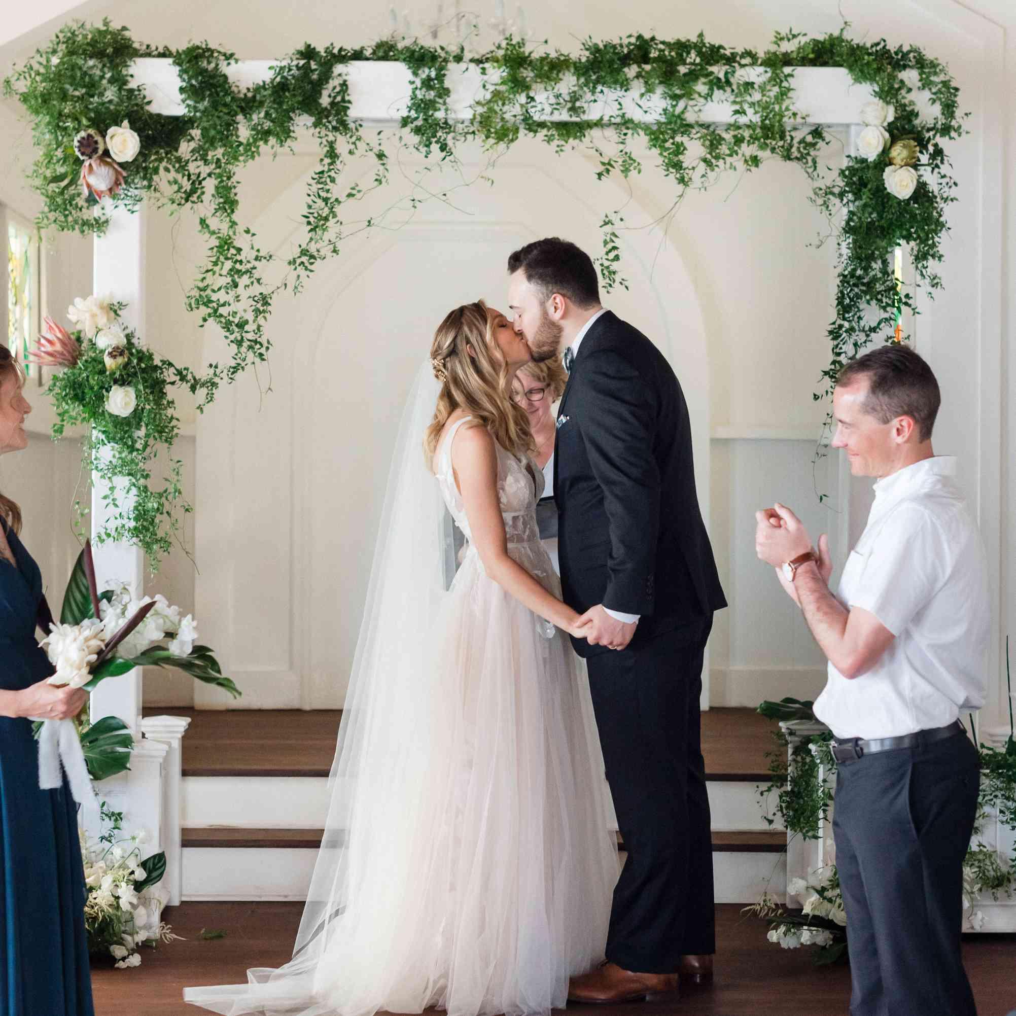 tropical maui wedding, bride and groom kissing ceremony
