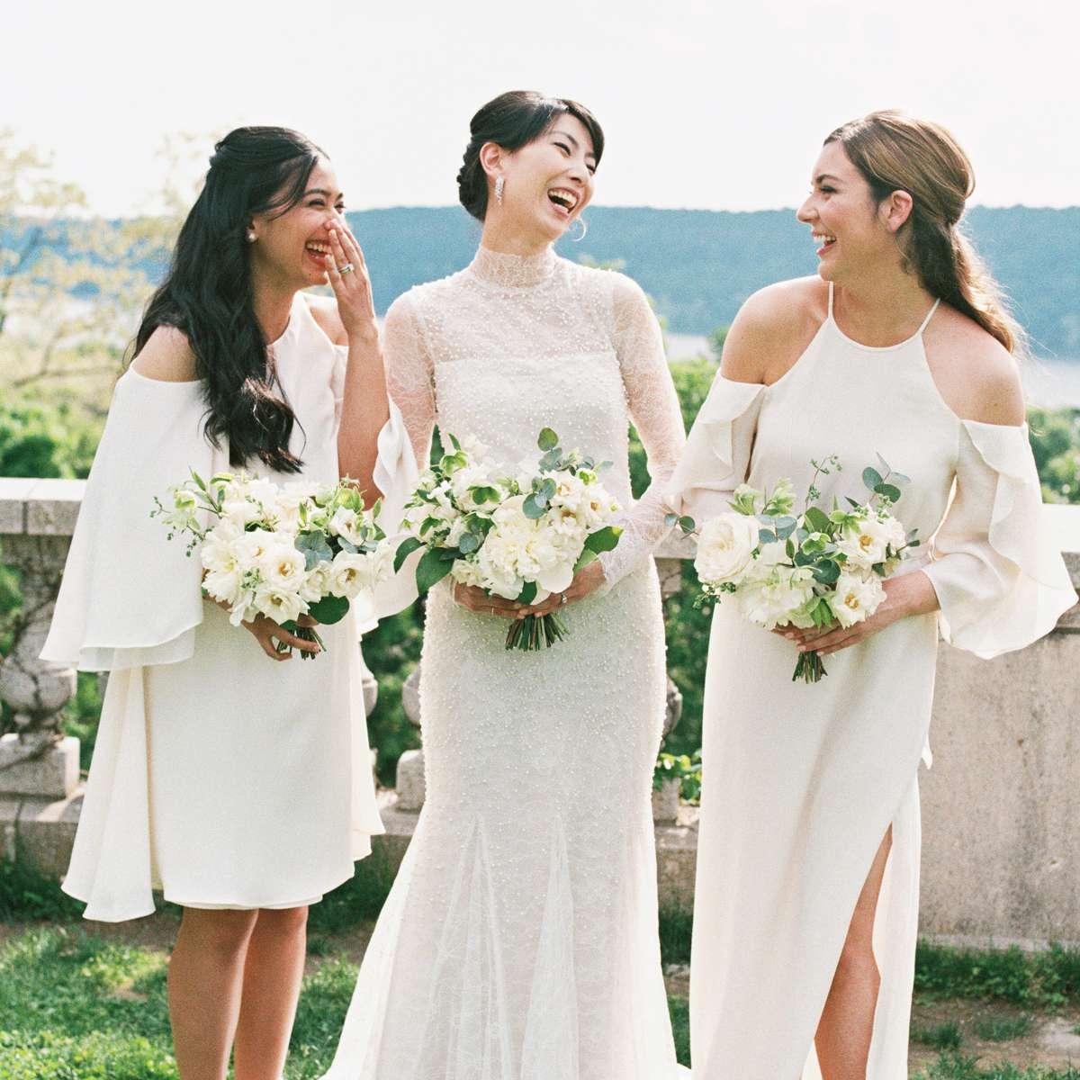 Bridesmaids with half-up 'dos and bride