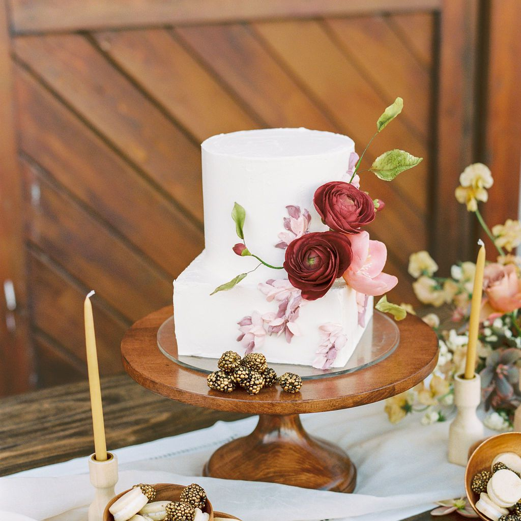 two tiered cake with sugar flowers