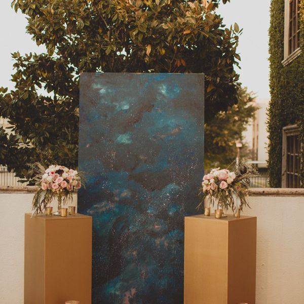 A galaxy-inspired ceremony backdrop