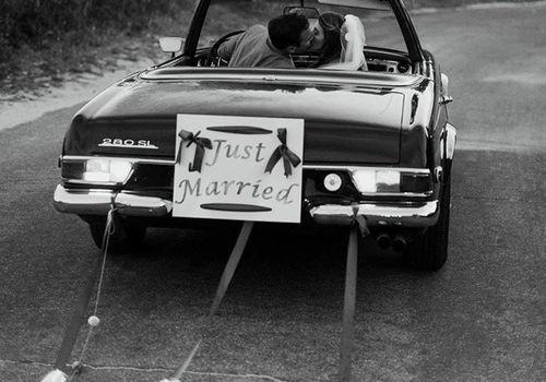 Wedding getaway car with tin cans