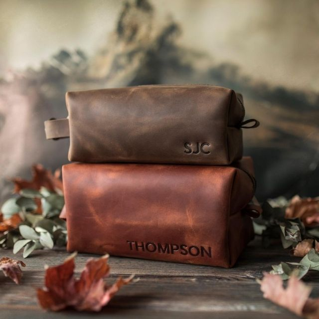 Lovingly handmade in a small studio using old-school leather working techniques, these dopp kits are perfect for your guy or groomsmen. They come custom hot-stamped with a name or initial making his personal toiletries bag