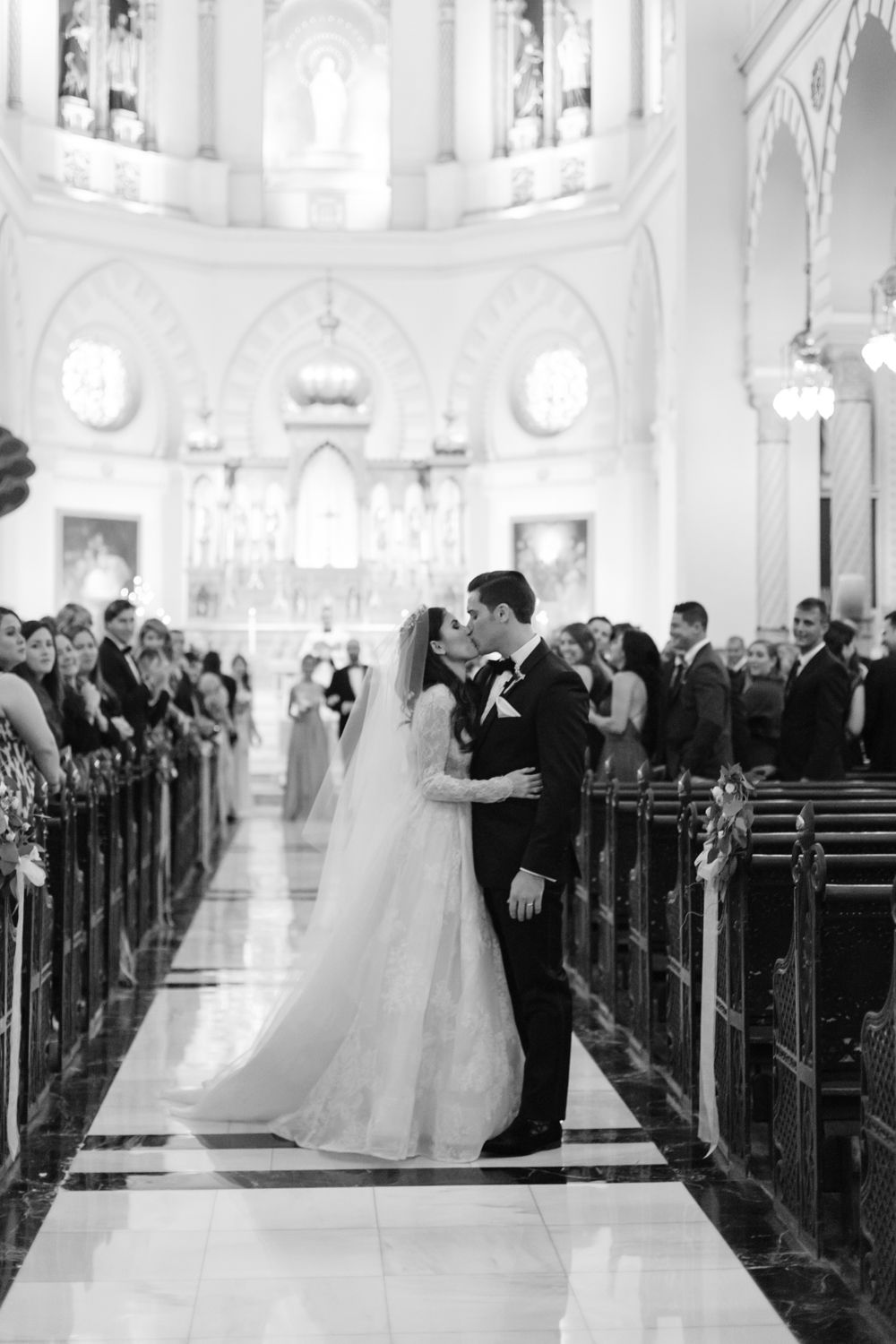 <p>Bride and groom kissing during ceremony</p><br><br>