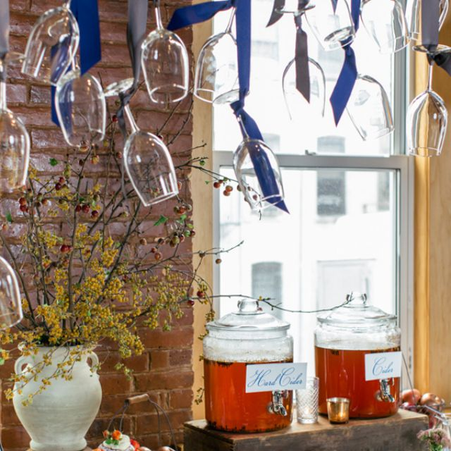Apple cider bar with hanging wine glass display