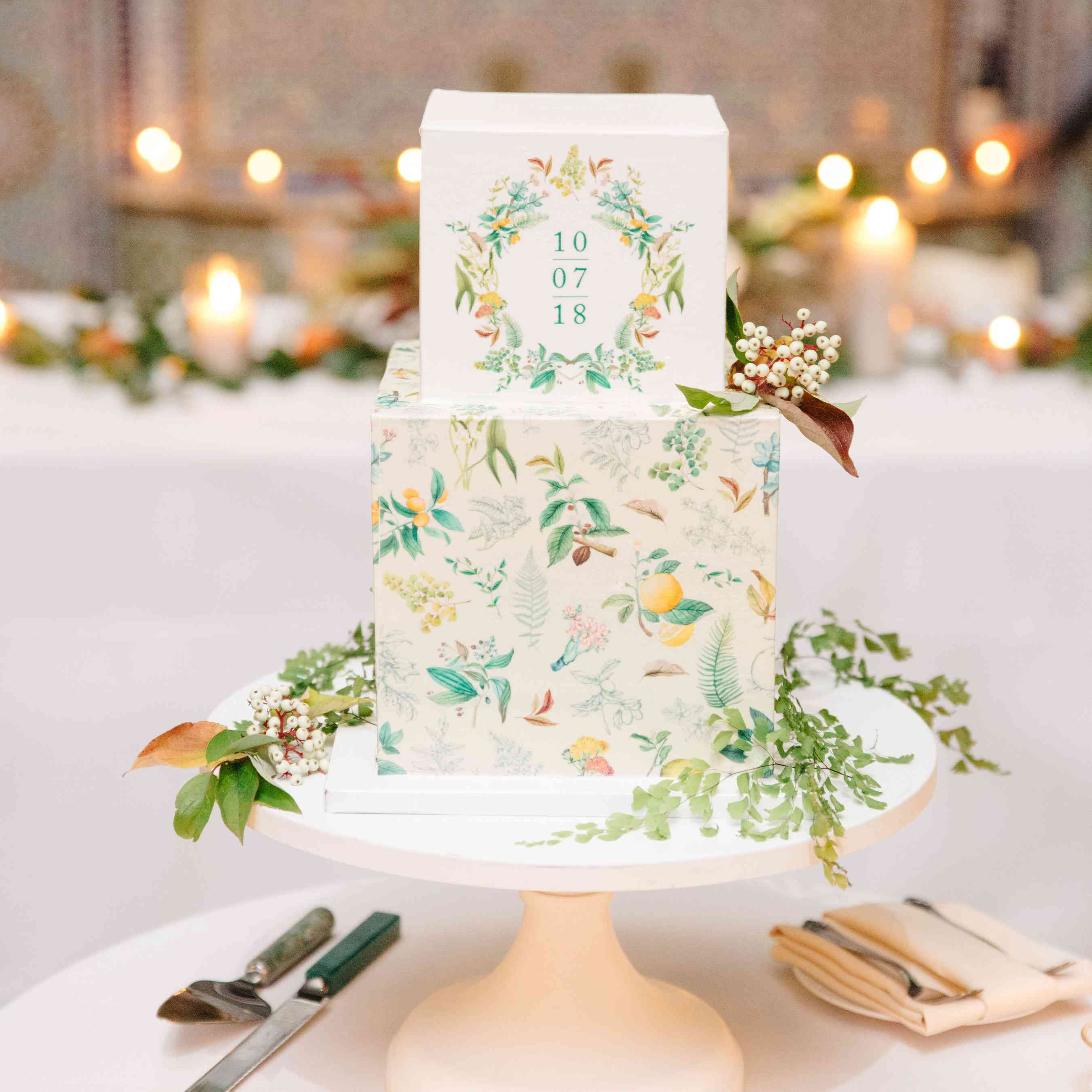 Square tiered wedding cake with hand-painted details and wedding date