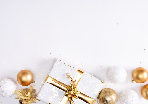 White and gold wrapped gifts and ornaments