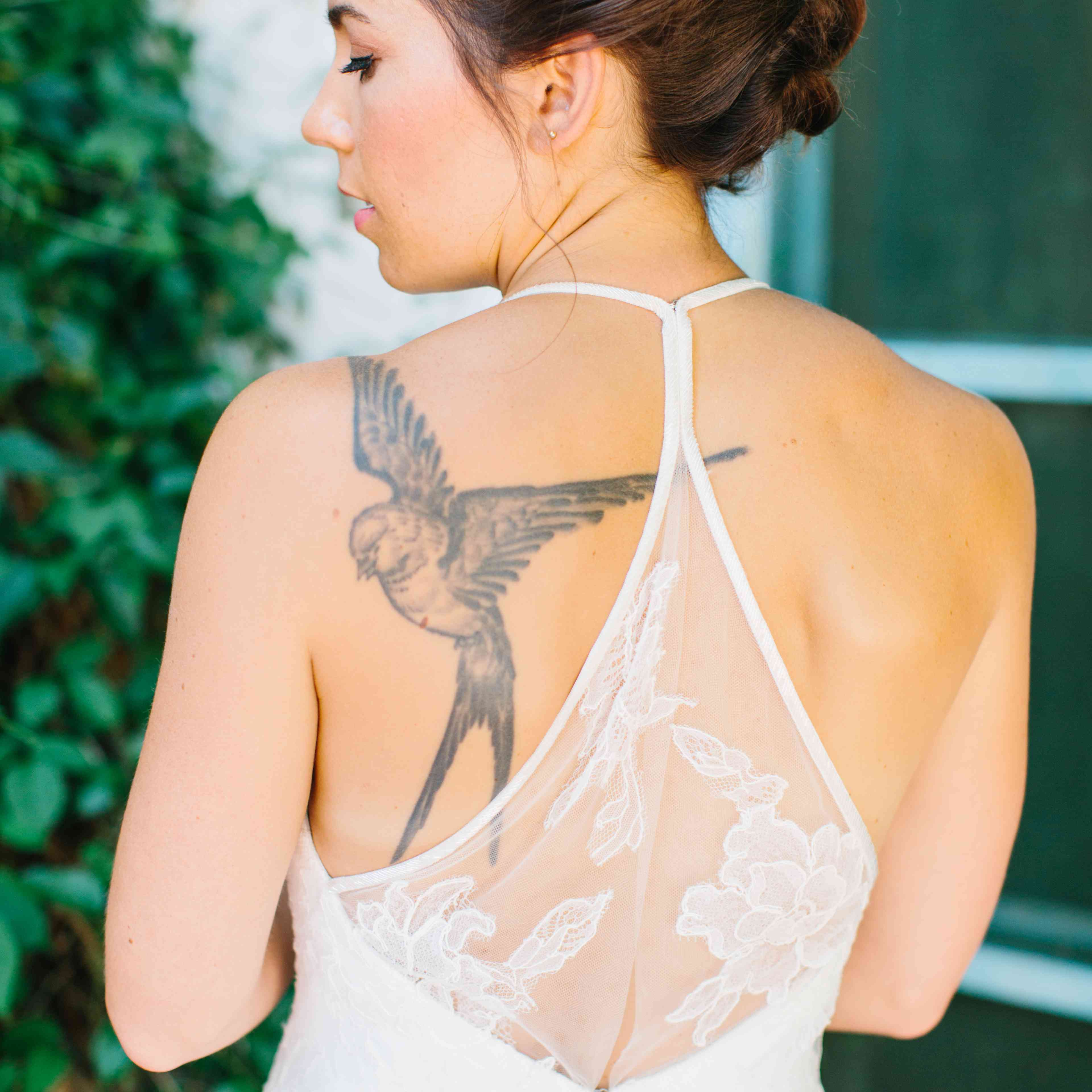 Bride with sparrow tattoo on shoulder