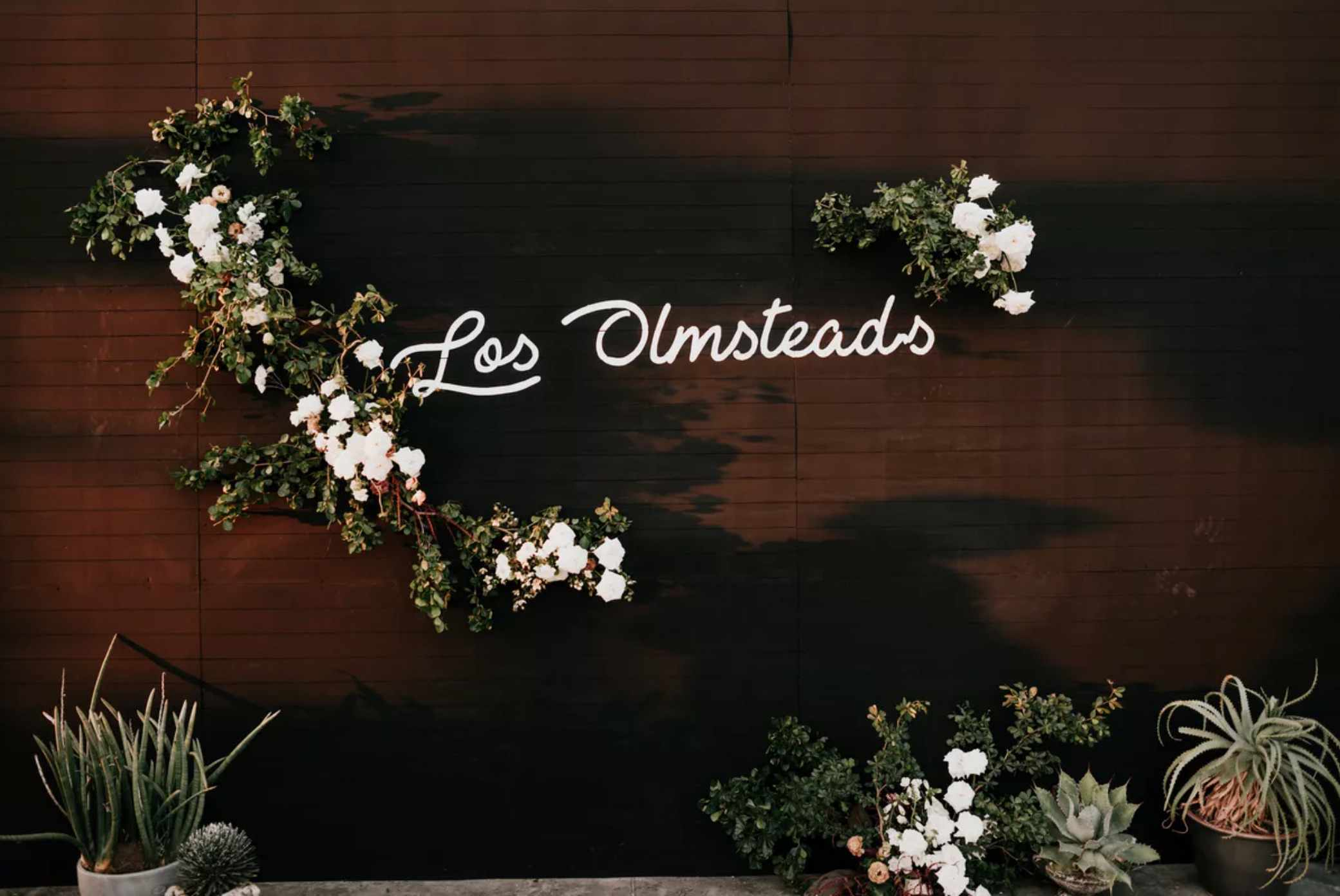 White neon sign with floral accents