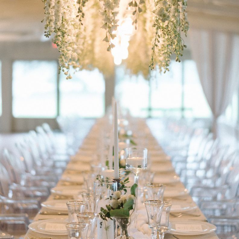 Table setup with white hanging florals