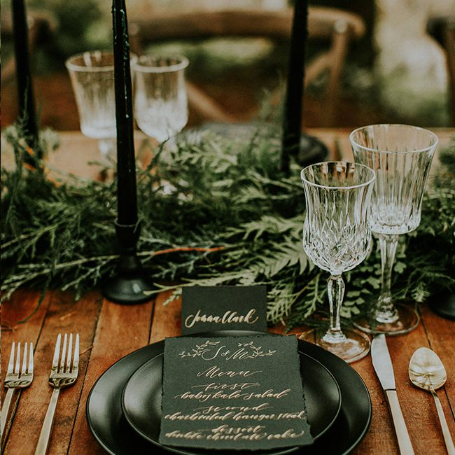 Forest green candles on tablescape