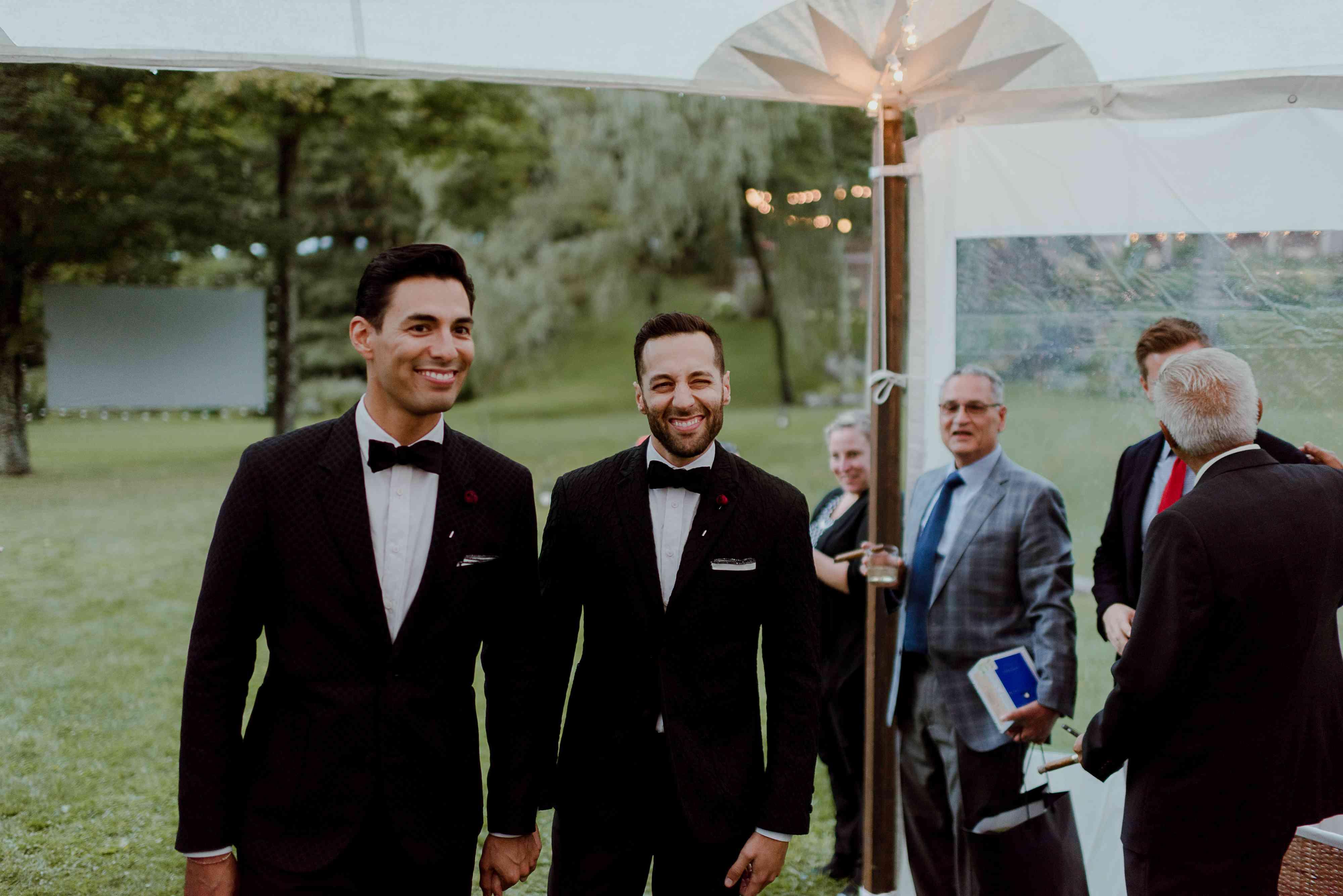 Grooms entering wedding reception
