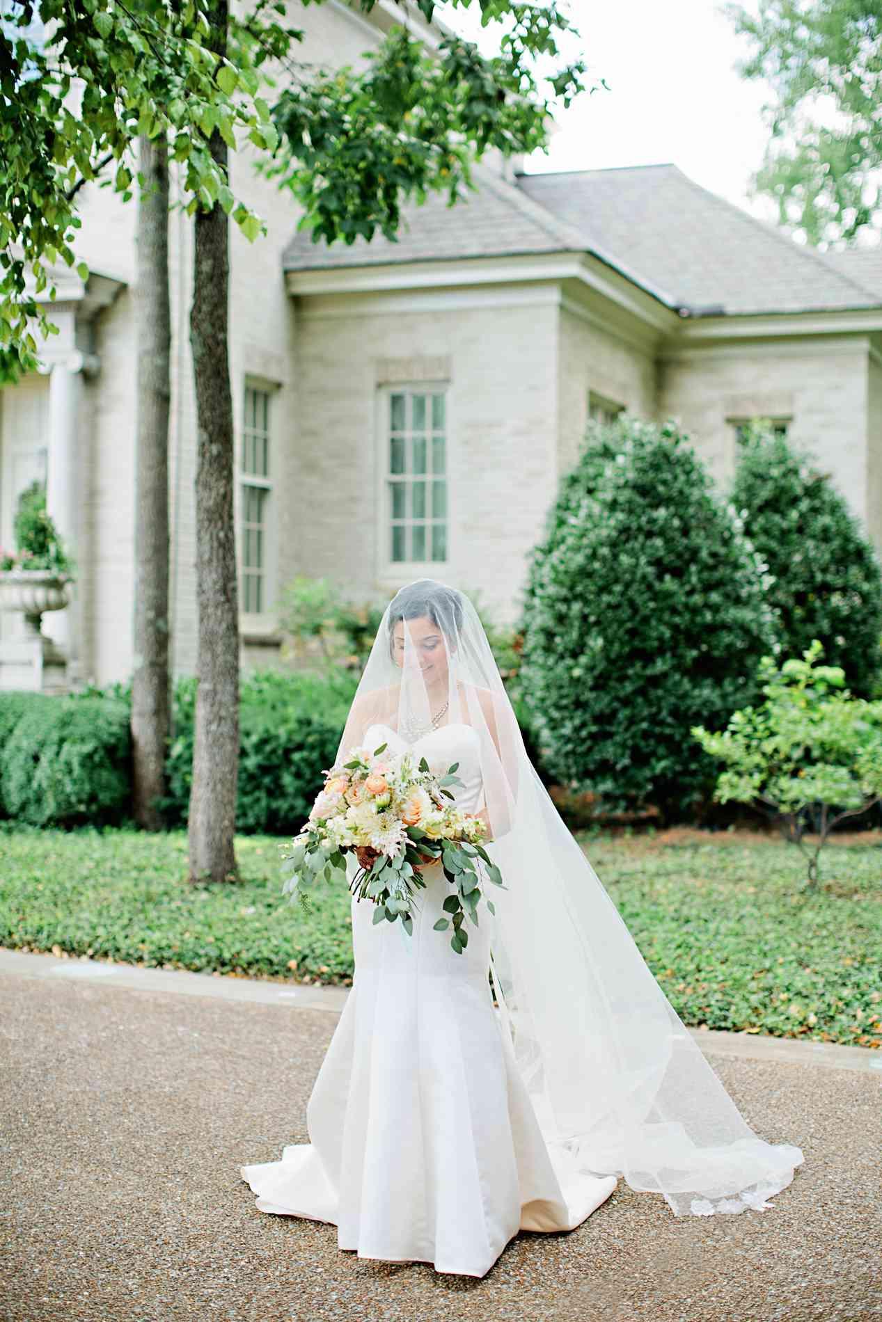 Bride with bouquet solo shot