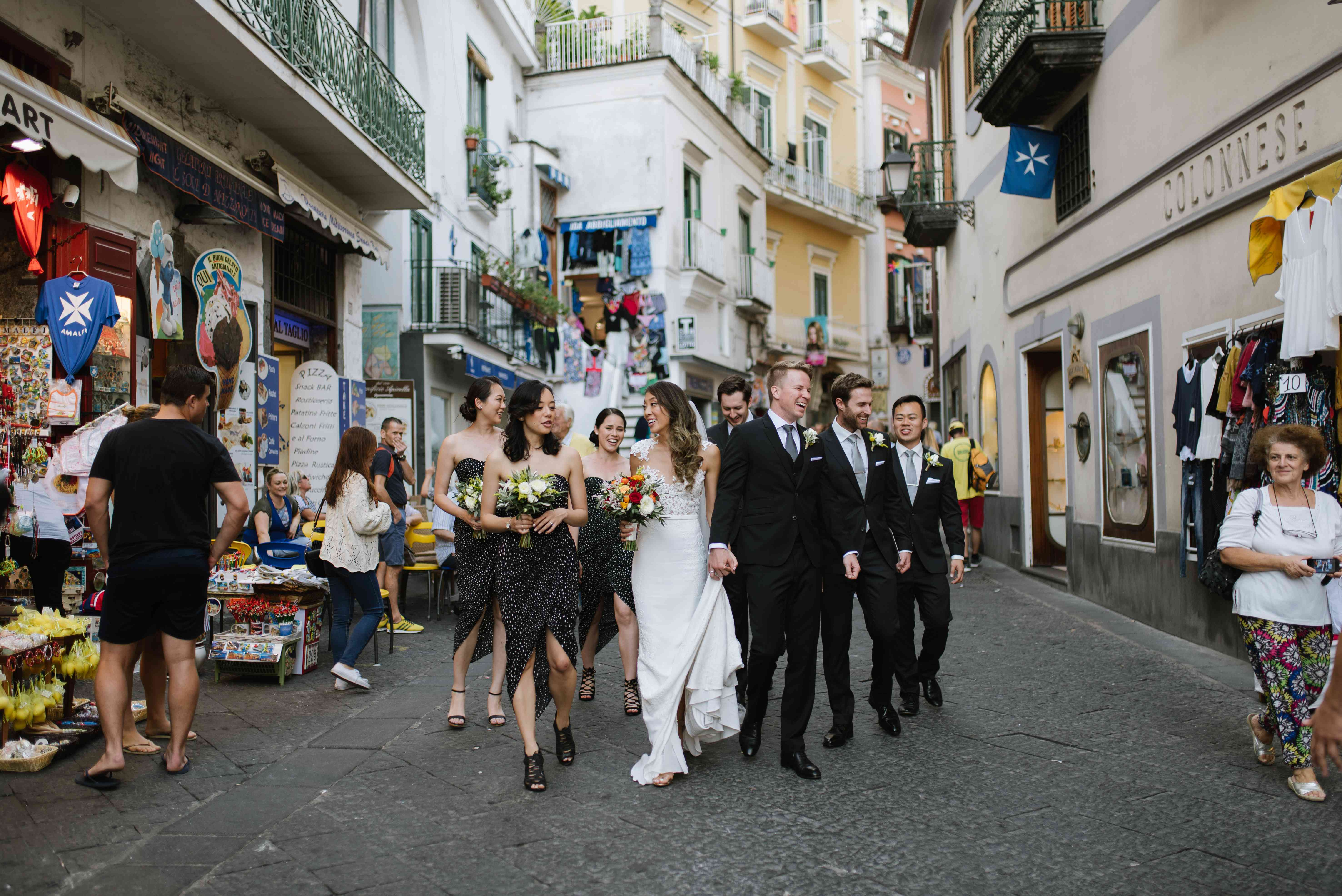 Bride and groom walking through streets